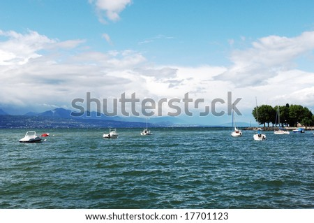 Sail Boats Docked in Harbor with clouds and blue sky