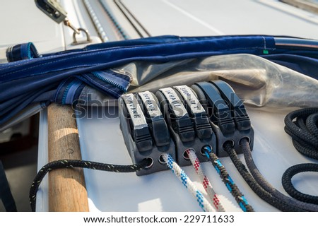 Sailing boat ropes at stoppers. Yachting details.
