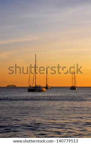 Sailing Boats moored in Rodney Bay, St Lucia at sunset.