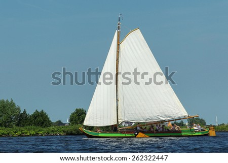 Sailing on an old typical dutch wooden sailing boat