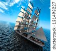 Sailing ship in the vast ocean with small waves is getting all the sails filled with sea breeze - stock photo