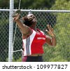 SAINT JOHN, CANADA - AUGUST 10: Geraldine George Francis of Trinidad & Tobago at the North, Central American & Caribbean Masters Track & Field Championships August 10, 2012 in Saint John, Canada. - stock photo