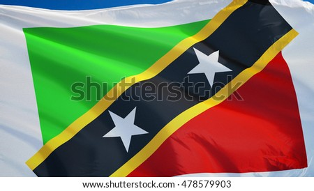Saint Kitts and Nevis flag waving against clean blue sky, close up, isolated with clipping path mask alpha channel transparency
