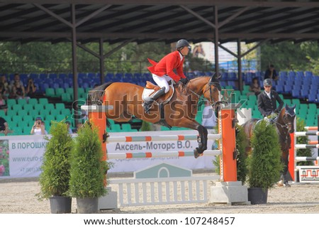 SAINT-PETERSBURG - JULY 07: Rider Mikhail Safronov on Washington in Jumping show, stage of the International show jumping event CSI3*-W/CSIYH1*, on July 07, 2012 in Saint Petersburg, Russia.