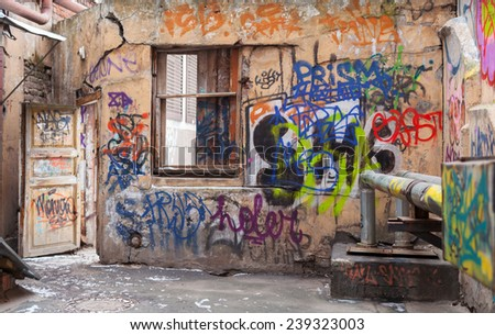 Saint-Petersburg, Russia - March 11, 2014: Old courtyard walls painted with colorful chaotic graffiti. Central part of St.Petersburg city