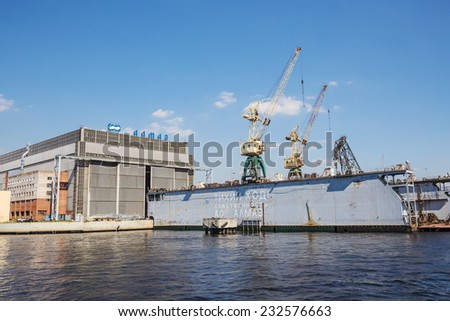 SAINT-PETERSBURG, RUSSIA - MAY 23, 2014: Dock of ALMAZ Shipbuilding Company, St.-Petersburg. Company specializes in high-speed ships and boats building