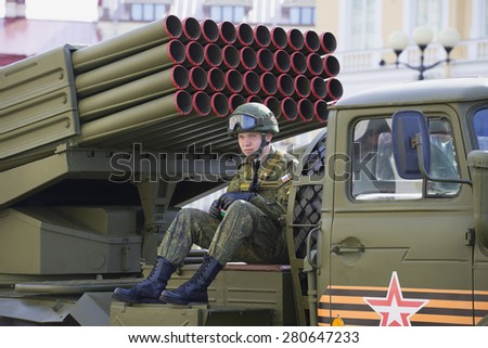 "SAINT-PETERSBURG, RUSSIA - MAY 05, 2015: Russian soldier sits on the launcher ""Grad"". Preparations for the parade in honor of Victory Day"