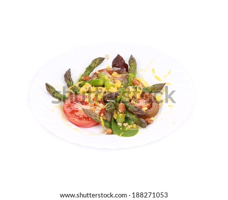 Salad with asparagus. Isolated on a white background.