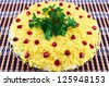 Salad with boiled egg, cream sauce and pomegranate seeds on a plate - stock photo