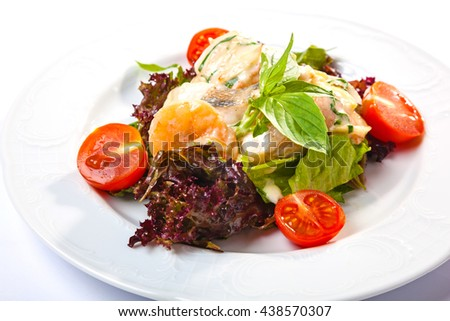 Salad with fish sauce on plate