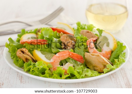 salad with shrimps and mussels on the plate