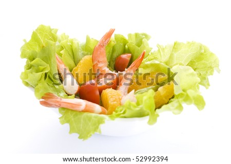 salad with shrimps, oranges and tomatoes isolated on white background