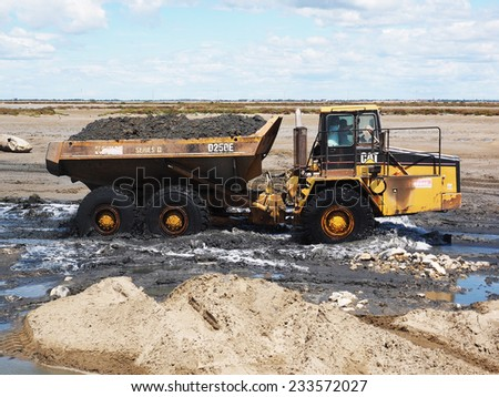 SALIN DE GIRAUD, FRANCE - JULY, 7, 2014. Construction of a  new dike in the Salt Marsh of Salin de Giraud.