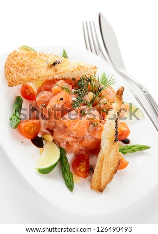 Salmon carpaccio in plate isolated on white background