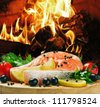 salmon steak with vegetables cooked on the grill - stock photo