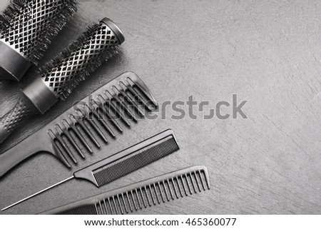 Salon Hairdresser Accessories, Comb and brashing for cutting hair  on a black background