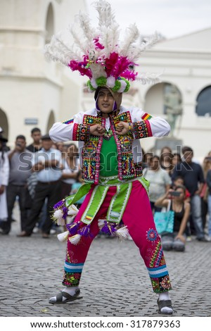 SALTA, ARGENTINA, DEC 18: Young adult performer dancing and celebrating the opening of the carnival of Salta in the street with colorful costumes. North of Argentina 2014
