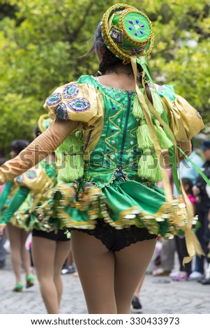 SALTA, ARGENTINA, DEC 18: Young women performers dancing and celebrating the opening of the carnival of Salta in the street with colorful costumes. North of Argentina 2014