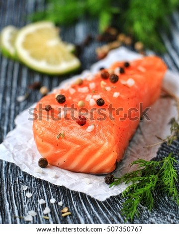 Salted red fish on a black background