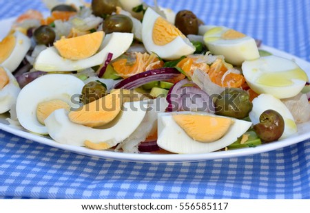 salted tuna salad with avocado, orange, onion, hard boiled eggs, olives and olive oil