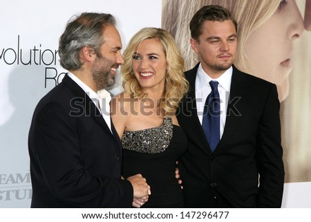 "Sam Mendes, Kate Winslet,  & Leonardo DiCaprio arriving at the World Premiere of ""Revolutionary Road"" at the Mann's Village Theater in Westwood, CA on December 15, 2008"