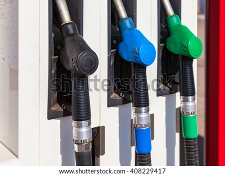 SAMARA, RUSSIA - APRIL 16, 2016: Gas pump nozzles with different fuels at the gas station