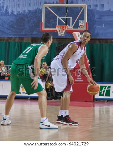 SAMARA, RUSSIA - OCTOBER 24: Gerald Green of BC Krasnye Krylia with the ball attacking player of BC UNICS October 24, 2010 in Samara, Russia.