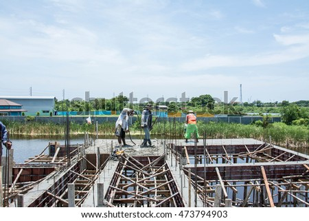 Samutprakarn, Thailand July 22,2016: worker pouring  concrete  works at construction site