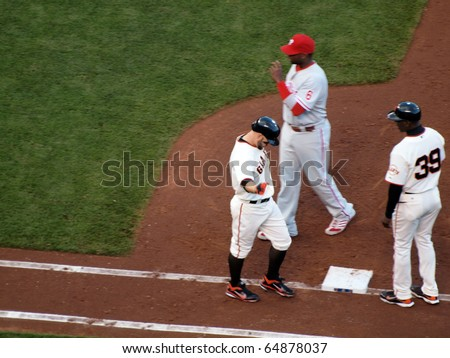 SAN FRANCISCO, CA - OCTOBER 20: Cody Ross reaches out arm as he walks to 1st base after he was hit by a pitch game 4 2010 NLCS between Giants and Phillies Oct. 20, 2010 AT&T Park San Francisco.