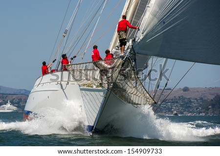 SAN FRANCISCO, CA - SEPTEMBER 13: A super yacht competes in a regatta during the America's Cup in San Francisco, CA on September 13, 2013