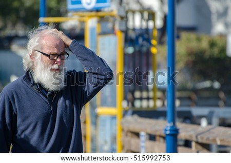 SAN FRANCISCO, CALIFORNIA - MARCH 1, 2015: surprised older man on Pier 39. San Francisco. USA
