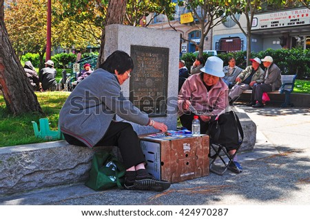 San Francisco, Usa: women play cards in Portsmouth Square on June 15, 2010.  Portsmouth Square is a park in the heart of the Chinatown neighborhood, which is the oldest Chinatown in North America