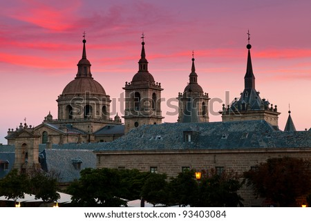San Lorenzo de El Escorial Monastery  with beautiful sky right after sunset. Four towers are set off by sky with pink and purple hues.