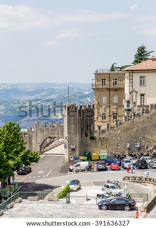 SAN MARINO REPUBLIC - JUNE 22, 2014: The woll of Guaita fortress is the oldest and the most famous tower on San Marino.