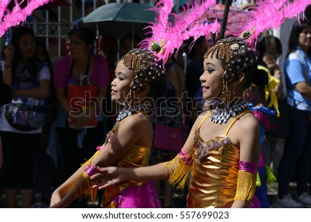 SAN PABLO CITY, LAGUNA, PHILIPPINES - JANUARY 13, 2017: Group of Street dancer in colorful coconut costumes participated in celebrating the feast of St. Paul the First Hermit
