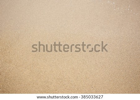 Sand at the beach background. Drop space on bottom right for text and other.
