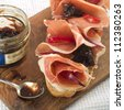 Sandwich with ham and onion jam, selective focus - stock photo