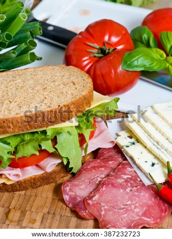 Sandwich with lettuce, tomato, ham and cheese