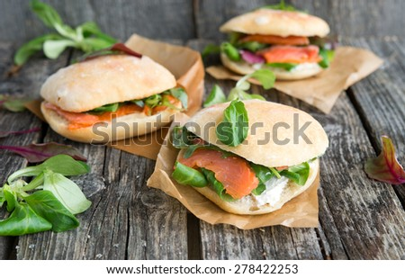 sandwich with red fish and greens