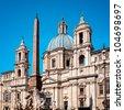 Sant'Agnese in Agnone and Bernini's monumental Fontana dei Fiumi in Rome. - stock photo