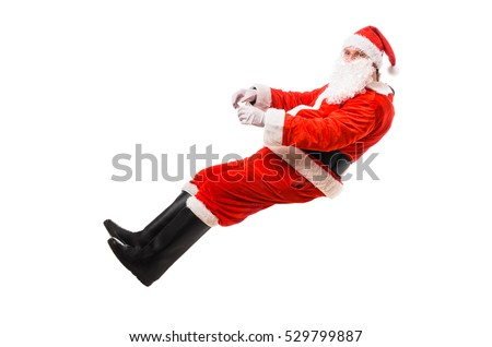 Santa Claus driving imaginary car, isolated on white background