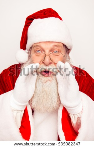 Santa Claus holding hands near mouth and telling news
