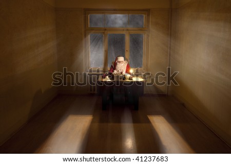 Santa Claus in a big room sitting by the desk. Light shining through the window.