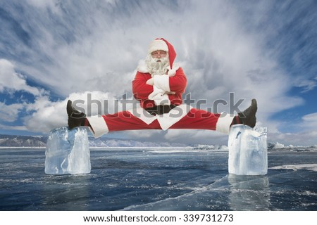 Santa Claus makes stretching between two ice cubes