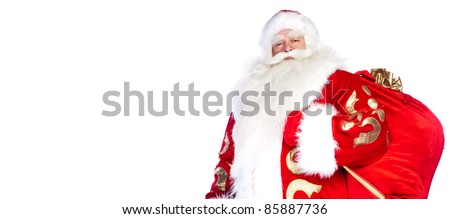 Santa Claus standing up on white background with his bag full of gifts