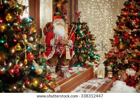 Santa Claus toy on a Christmas wooden porch. Christmas concept