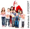 Santa Claus with a group of kids holding Christmas presents - isolated - stock photo