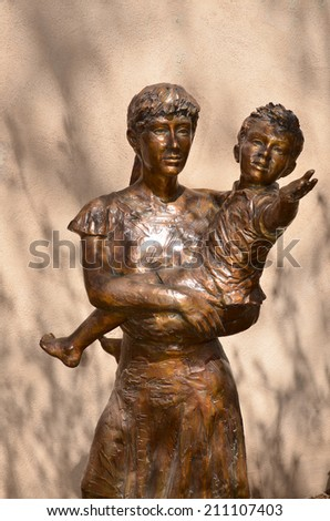 SANTA FE, NM USA APRIL 21: Mother and child sculpture, Santa Fe, NM: on april 21, 2014 in Santa Fe, NM. Works of art are an integral part of the beauty and spirit of the city;