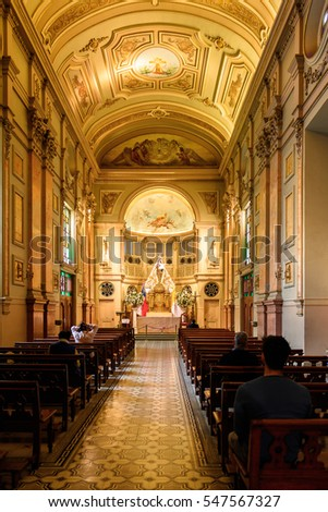 SANTIAGO, CHILE - NOV 1, 2014:  Interior of the Metropolitan Cathedral in Santiago. One of the most important places in Santiago