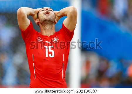 SAO PAULO, BRAZIL - July 1, 2014: Blerim Dzemaili of Switzerland regrets loosing a goal opportunity during the Round of 16 game against Argentina at Arena Corinthians. No Use in Brazil.